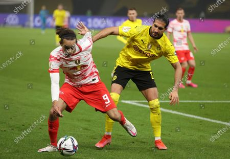 Leipzig's Yussuf Poulsen, left, and Dortmund's Emre Can challenge for the ball during the German soccer cup (DFB Pokal) final match between RB Leipzig and Borussia Dortmund in Berlin, Germany
