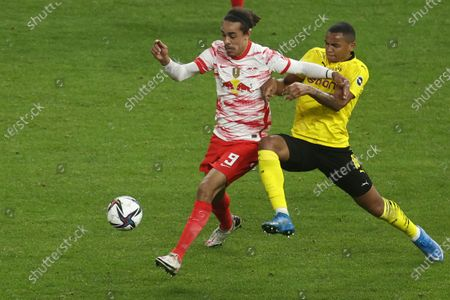 Leipzig's Yussuf Poulsen, left, is challenged by Dortmund's Manuel Akanji during the German soccer cup (DFB Pokal) final match between RB Leipzig and Borussia Dortmund in Berlin, Germany