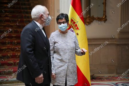 Spanish Foreign Minister Arancha Gonzalez Laya (R) welcomes her Iranian counterpart Mohammad Javad Zarif (L) for a bilateral meeting at Viana Palace in Madrid, Spain, 13 May 2021.