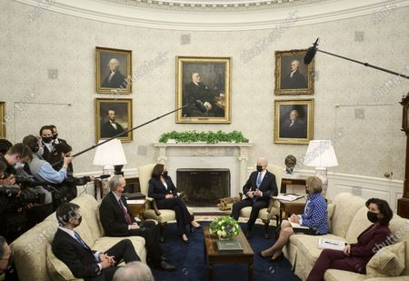 US President Joe Biden, with Vice President Kamala Harris, makes a brief statement to the press during a meeting with a group of republican senators to discuss the administration's infrastructure plan, in the Oval Office at the White House in Washington, DC, USA, on 13 May 2021. Included in the meeting were Transportation Secretary Pete Buttigeig, from left, Sen. Mike Crapo (R-ID), Sen. Shelley Capito (R-WV), and Commerce Secretary Gina Raimondo.