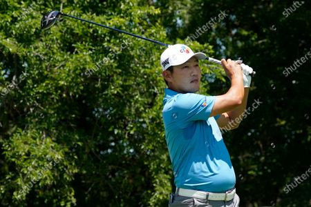 Sung Kang, of South Korea, hits on the second tee during the first round of the AT&T Byron Nelson golf tournament, in McKinney, Texas