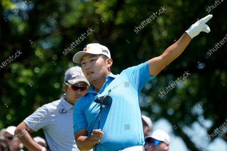 Sung Kang, of South Korea, reacts to his tee shot on the fifth hole during the first round of the AT&T Byron Nelson golf tournament, in McKinney, Texas