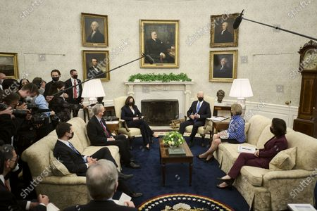 United States President Joe Biden, with US Vice President Kamala Harris, makes a brief statement to the press during a meeting with a group of Republican senators to discuss the administration's infrastructure plan, in the Oval Office at the White House in Washington, D.C.,. Included in the meeting were US Secretary of Transportation Pete Buttigieg, from left, US Senator Mike Crapo (Republican of Idaho), US Senator Shelley Moore Capito (Republican of West Virginia), and US Secretary of Commerce Gina Raimondo.