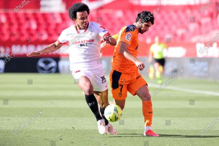 Jules Kounde of Sevilla FC and Goncalo Guedes of Valencia CF during the La Liga match between Sevilla FC and Valencia CF at Estadio Sanchez Pizjuan in Sevilla, Spain.