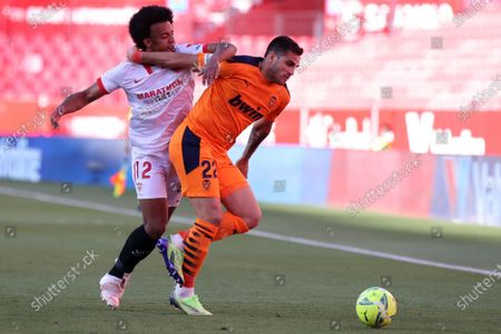 Stock Photo of Jules Kounde of Sevilla FC and Maxi Gomez of Valencia CF during the La Liga match between Sevilla FC and Valencia CF at Estadio Sanchez Pizjuan in Sevilla, Spain.