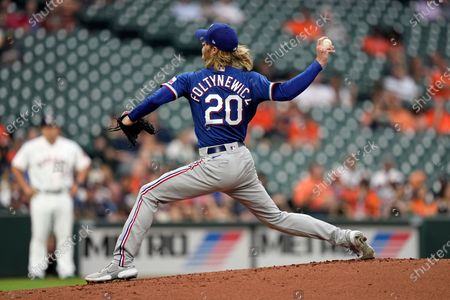 Texas Rangers starting pitcher Mike Foltynewicz throws against the Houston Astros during the first inning of a baseball game, in Houston