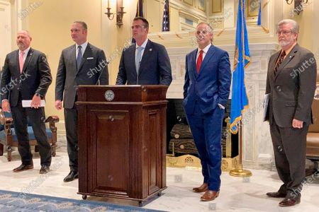 Oklahoma Gov. Kevin Stitt, center, speaks as, from left, House Appropriations Chairman Rep. Kevin Wallace, House Speaker Charles McCall, Senate president Pro Tempore Greg Treat and Senate Appropriations Chairman Roger Thompson listen, during a news conference at the Capitol, in Oklahoma City. Gov. Stitt and Republican leaders in the House and Senate reached a deal on a $8.3 billion spending plan for the upcoming fiscal year, they announced Thursday