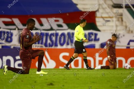 LDU Quito's Anderson Rafael Ordonez (L) and Luis Miguel Ayala (R) react after a group G match of the Copa Libertadores, at the Jose Amalfitani Stadium in Buenos Aires, Argentina, 13 May 2021.