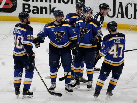 St. Louis Blues' David Perron (57) celebrates with Ryan O'Reilly (90), Torey Krug (47), Mike Hoffman (68) and Brayden Schenn (10) after scoring his second goal of the night, during the third period of an NHL hockey game against the Minnesota Wild, in St. Louis. The Blues erased a 3-0 deficit to win 7-3