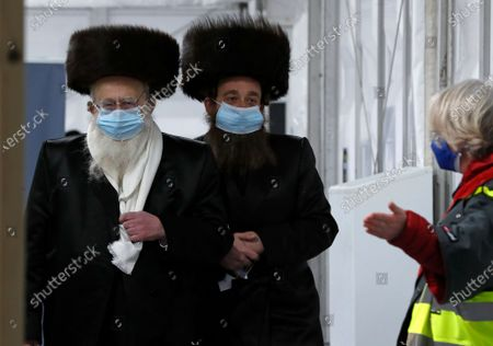 Two men from the Haredi Orthodox Jewish community arrive at an event to encourage vaccine uptake in Britain's Haredi community at the John Scott Vaccination Centre in London. Thanks to an efficient vaccine roll out program and high uptake rates, Britain is finally saying goodbye to months of tough lockdown restrictions. From Monday May 17, 2021, all restaurants and bars can fully reopen, as can hotels, cinemas, theatres and museums, and for the first time since March 2020, Britons can hug friends and family and meet up inside other people's houses