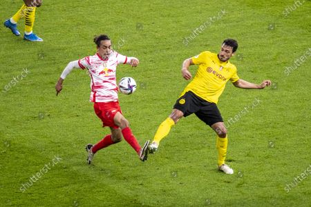 Stock Photo of Leipzig's Yussuf Poulsen (l) and Dortmund's Mats Hummels are fighting for the ball.
