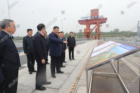 Chinese President Xi Jinping, also general secretary of the Communist Party of China Central Committee and chairman of the Central Military Commission, inspects the Taocha Canal Head and listens to introductions to the construction, management and operation of the middle route of the South-to-North Water Diversion Project, and the ecological conservation of the water source region in Xichuan County, Nanyang, Central China's Henan Province, May 13, 2021.