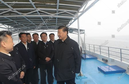 Chinese President Xi Jinping, general secretary of the Communist Party of China Central Committee and chairman of the Central Military Commission, inspects the Danjiangkou Reservoir and listens to introductions to the construction, management and operation of the middle route of the South-to-North Water Diversion Project, and the ecological conservation of the water source region in Xichuan County, Nanyang, Central China's Henan Province, May 13, 2021.