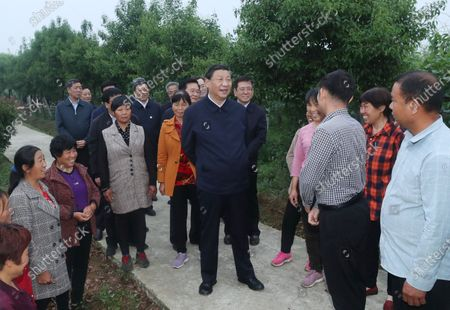Chinese President Xi Jinping, general secretary of the Communist Party of China Central Committee and chairman of the Central Military Commission, learn about the resettlement of people relocated because of the South-to-North Water Diversion Project, and measures to develop specialty industries and boost the incomes of resettled residents in Zouzhuang Village, Xichuan County, Nanyang, Central China's Henan Province, May 13, 2021.