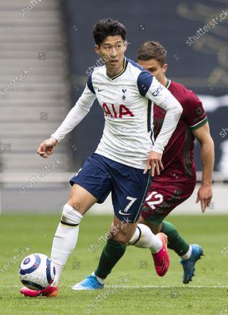 Stock Photo of Son Heung-Min of Tottenham Hotspur under pressure from Leander Dendoncker of Wolverhampton Wanderers