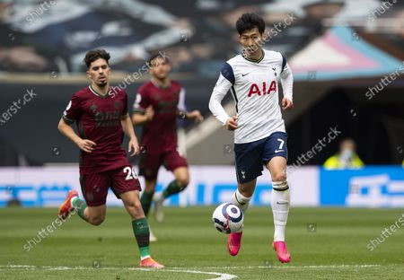 Son Heung-Min of Tottenham Hotspur chased by Vitinha of Wolverhampton Wanderers