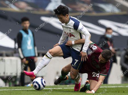 João Moutinho of Wolverhampton Wanderers pulls back Son Heung-Min of Tottenham Hotspur