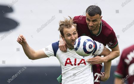 Harry Kane of Tottenham Hotspur and Romain Saïss of Wolverhampton Wanderers battle for the ball