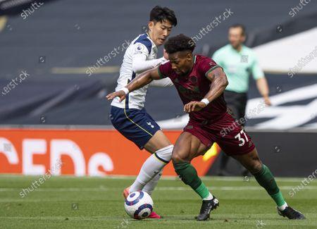 Stock Picture of Adama Traoré of Wolverhampton Wanderers turns Son Heung-Min of Tottenham Hotspur