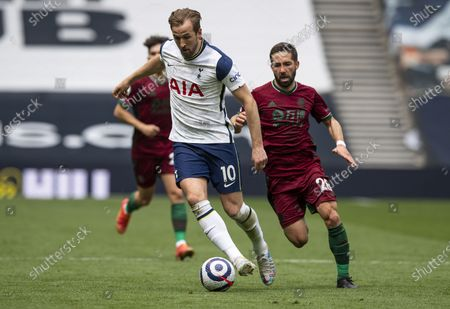 Stock Photo of Harry Kane of Tottenham Hotspur chased by João Moutinho of Wolverhampton Wanderers
