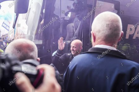 Rangers Fans celebrate becoming champions outside Ibrox stadium as the Rangers team coach arrives at the stadium and Rangers Assistant Manager Gary McAllister gets off