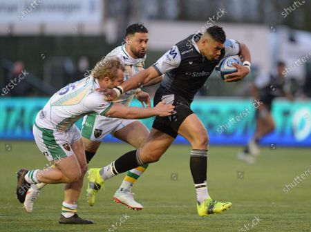 Stock Picture of Luther Burrell  of Newcastle Falcons fends off Mike Haywood of Northampton Saints