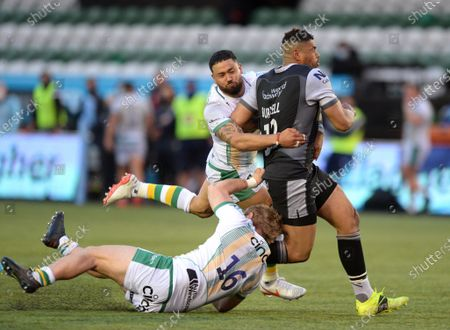 Stock Photo of Mike Haywood of Northampton Saints tries to bring down Luther Burrell of Newcastle Falcons