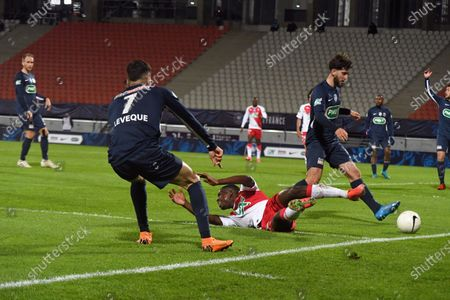 Rumilly Vallieres' French midfielder Joris Cottin (R) fights for the ball with Monaco's Portuguese midfielder Gelson Martins during the French Cup semi-final football match between GFA Rumilly Vallieres and AS Monaco at the Parc des Sports Stadium in Annecy, eastern France on May 13, 2021.
