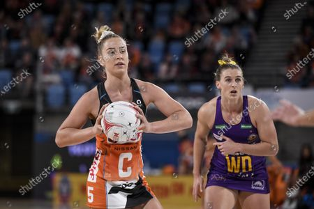 Jamie-Lee Price of the Giants Netball passes the ball as Gabi Simpson of Queensland Firebirds watches; Ken Rosewall Arena, Sydney, New South Wales, Australia; Australian Suncorp Super Netball, Giants Netball versus Queensland Firebirds.