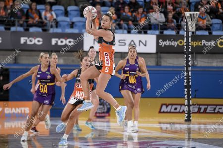 Jamie-Lee Price of the Giants Netball jumps and catches a pass; Ken Rosewall Arena, Sydney, New South Wales, Australia; Australian Suncorp Super Netball, Giants Netball versus Queensland Firebirds.