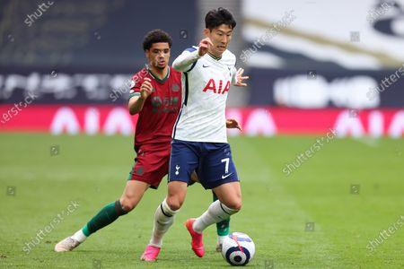 Son Heung-Min of Tottenham Hotspur under pressure from Ki-Jana Hoever of Wolverhampton Wanderers; Tottenham Hotspur Stadium, London, England; English Premier League Football, Tottenham Hotspur versus Wolverhampton Wanderers.