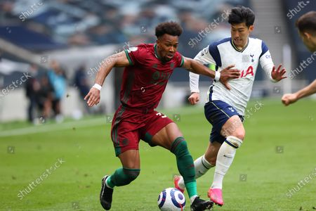 Adama Traore of Wolverhampton Wanderers competes for the ball with Son Heung-Min of Tottenham Hotspur; Tottenham Hotspur Stadium, London, England; English Premier League Football, Tottenham Hotspur versus Wolverhampton Wanderers.