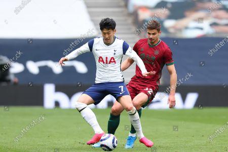 Son Heung-Min of Tottenham Hotspur under pressure from Leander Dendoncker of Wolverhampton Wanderers; Tottenham Hotspur Stadium, London, England; English Premier League Football, Tottenham Hotspur versus Wolverhampton Wanderers.