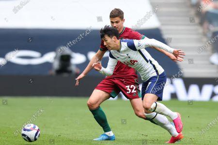 Son Heung-Min of Tottenham Hotspur takes on Leander Dendoncker of Wolverhampton Wanderers; Tottenham Hotspur Stadium, London, England; English Premier League Football, Tottenham Hotspur versus Wolverhampton Wanderers.