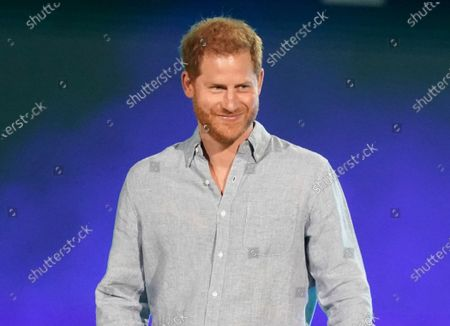 """Prince Harry, Duke of Sussex speaks at """"Vax Live: The Concert to Reunite the World"""" in Inglewood, Calif. on . Prince Harry compared his royal experience to being on """"The Truman Show"""" and """"living in a zoo."""" The Dutch of Sussex said he contemplated quitting royal life on several occasions during his 20s in a Thursday episode of the """"Armchair Expert"""" podcast"""