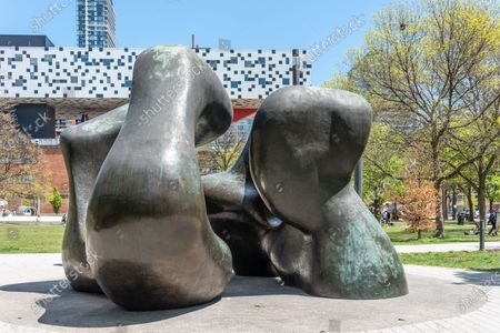 Sculpture named 'Large Two Forms' by Henry Moore. It is located in The Grange Park behind the Art Gallery of Ontario (AGO) in Toronto, Canada
