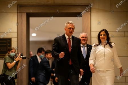 House Minority Leader Kevin McCarthy talks with Rep. Elise Stefanik (R-NY) as they walk to a news conference after a GOP Conference Chair election on Capitol Hill on Friday, May 14, 2021 in Washington, DC. House Republicans formally selected Rep. Elise Stefanik (R-NY) Friday to replace Rep. Liz Cheney (R-WY). (Kent Nishimura / Los Angeles Times)