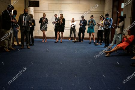 Reporters and Congressional staff wait in a hallway as GOP members arrive to cast their vote for the GOP Conference Chair election on Capitol Hill on Friday, May 14, 2021 in Washington, DC. House Republicans formally selected Rep. Elise Stefanik (R-NY) Friday to replace Rep. Liz Cheney (R-WY). (Kent Nishimura / Los Angeles Times)