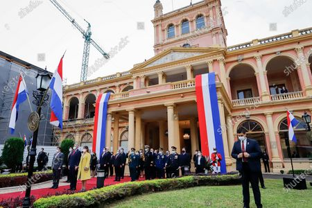 Mario Abdo Benítez, president of Paraguay, and authorities participate in the raising of the flag, at the Government Palace in Asuncion, Paraguay, 14 May 2021. Paraguay commemorated its 210th anniversary of independence this Friday, the second during the pandemic, with an official celebration in the Government Palace and the subsequent tedeum in the Cathedral with the presence of the president, Mario Abdo Benitez, and members of his Government. During the religious ceremony, the Archbishop of Asunción, Edmundo Valenzuela, delivered a homily with political and social overtones, in which he alluded to the 'pandemic and corruption'.