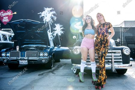 Morgan Walsh, on right, Co-owner of Cupid's Hot Dogs and employee Adrianna Gaxiola during the monthly Cruise Night at Cupid's Winnetka location on Saturday, April 24, 2021. (Mariah Tauger / Los Angeles Times)