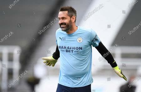 Manchester City's goalkeeper Scott Carson warms up prior to the English Premier League soccer match between Newcastle United and Manchester City at St James' Park stadium, in Newcastle, England