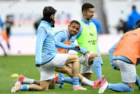 Manchester City's Gabriel Jesus, centre, warms up prior to the English Premier League soccer match between Newcastle United and Manchester City at St James' Park stadium, in Newcastle, England