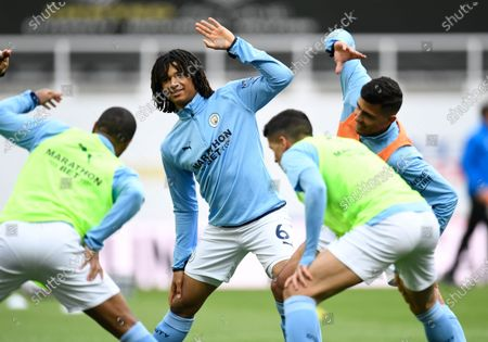 Manchester City's Nathan Ake, centre, warms up prior to the English Premier League soccer match between Newcastle United and Manchester City at St James' Park stadium, in Newcastle, England