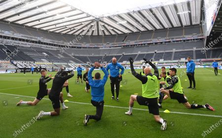 Newcastle United players warm up prior to the English Premier League soccer match between Newcastle United and Manchester City at St James' Park stadium, in Newcastle, England