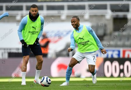 Stock Image of Manchester City's Kyle Walker, left, and Manchester City's Raheem Sterling warm up prior to the English Premier League soccer match between Newcastle United and Manchester City at St James' Park stadium, in Newcastle, England