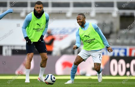 Manchester City players Kyle Walker (L) and Raheem Sterling (R) warm up for the English Premier League soccer match between Newcastle United and Manchester City in Newcastle, Britain, 14 May 2021.