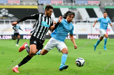 Newcastle's Joelinton (L) and Manchester City's Nathan Ake (R) in action during the English Premier League soccer match between Newcastle United and Manchester City in Newcastle, Britain, 14 May 2021.