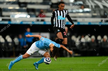 Stock Image of Manchester City's Nathan Ake (L) in action against Newcastle's Joe Willock (R) during the English Premier League soccer match between Newcastle United and Manchester City in Newcastle, Britain, 14 May 2021.