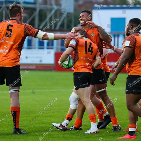 Stock Picture of Charlie Walker of Ealing Trailfinders is congratulated by Bobby de Wee and James Cannon after scoring a try
