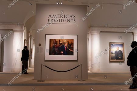 "Guests take in the National Portrait Gallery as it opened up today in Washington, DC on Friday, May 14, 2021. A photograph of former President Donald Trump will greet visitors to the National Portrait Gallery's ""America's Presidents"" when it opened Friday morning.    Photo by Tasos Katopodis/UPI"